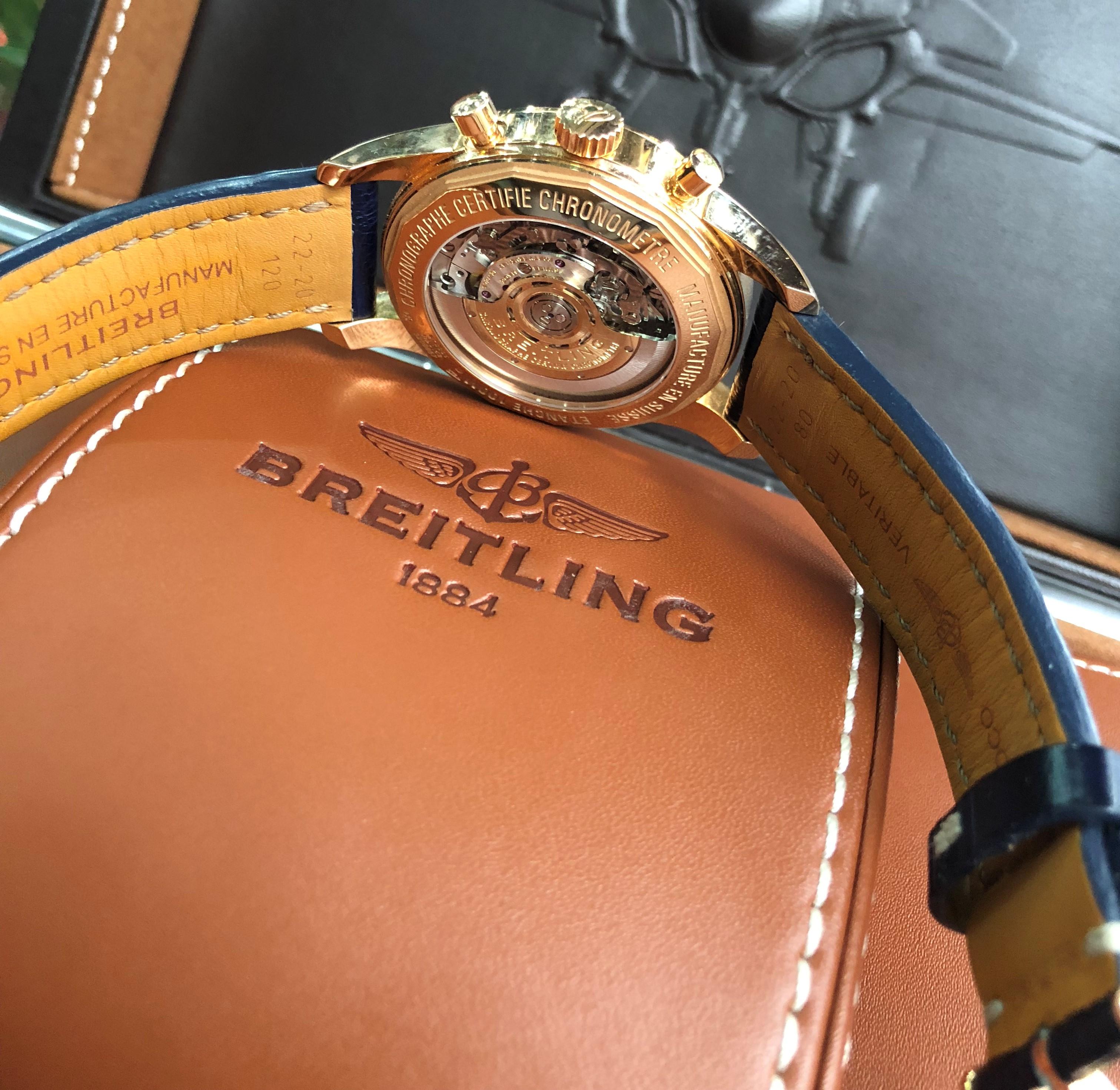 Breitling Transocean RB015212/C940-731P mặt xanh vàng hồng